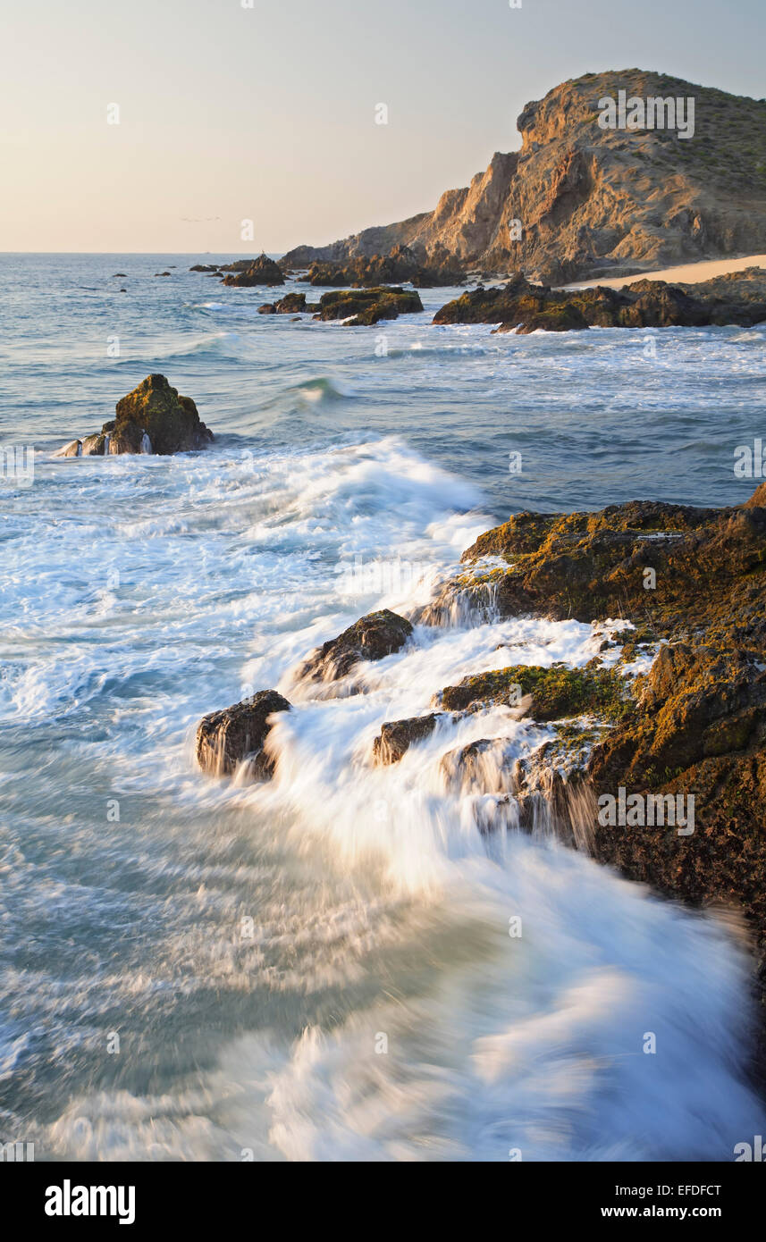 Waves crashing on rocks near Los Cedritos Beach, Todos Santos, Baja California Sur, Mexico - Stock Image