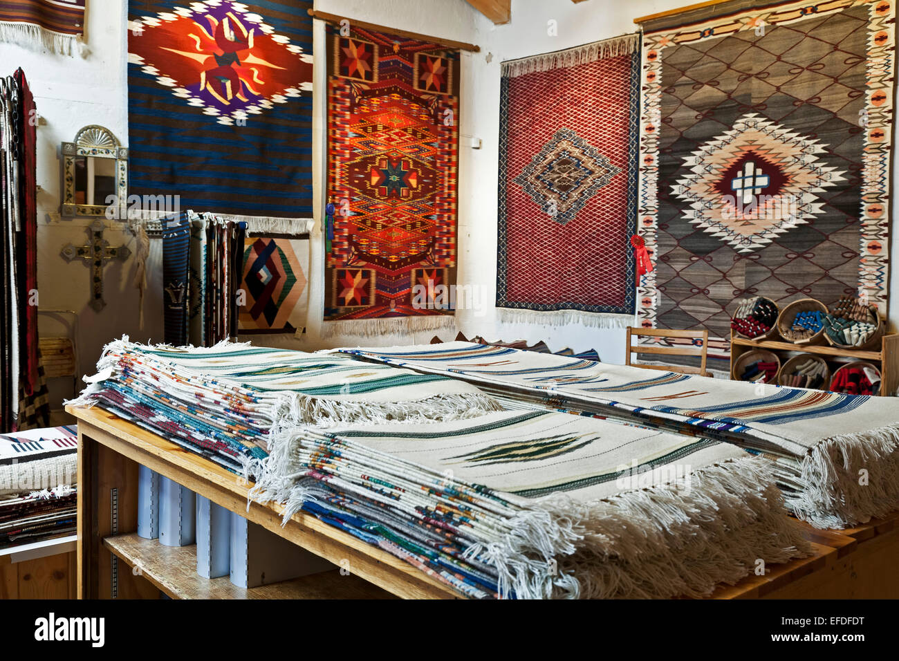 Wool blankets and rugs, Centinela Traditional Arts, Chimayo, New Mexico USA - Stock Image
