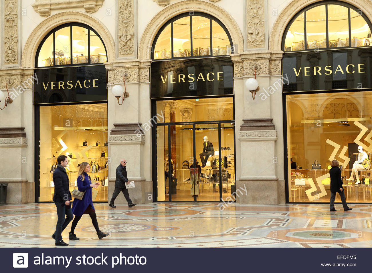 925ff9d9d4 The window of the Versace store in the Galleria Vittorio Emanuele II  shopping mall in Milan