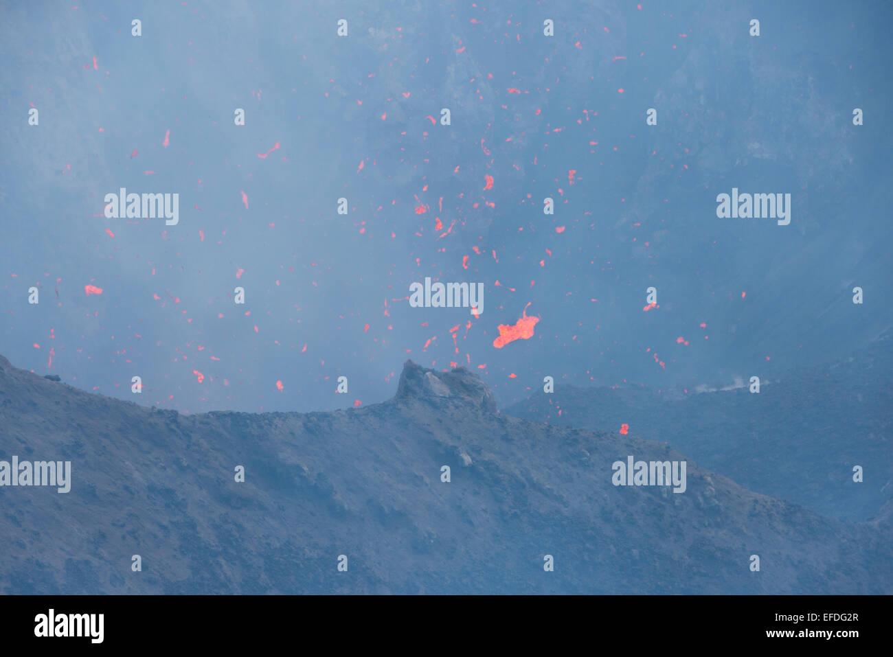 Melanesia, Vanuatu, Tanna Island. Mt. Yasur volcano. Crater overlook, view into steaming active volcano with molten Stock Photo