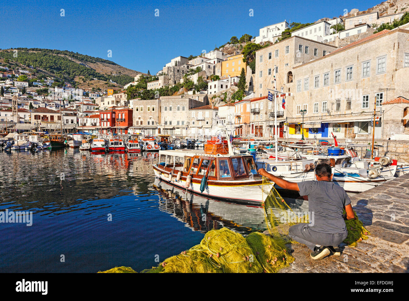 A fisherman in the port of Hydra in Greece - Stock Image