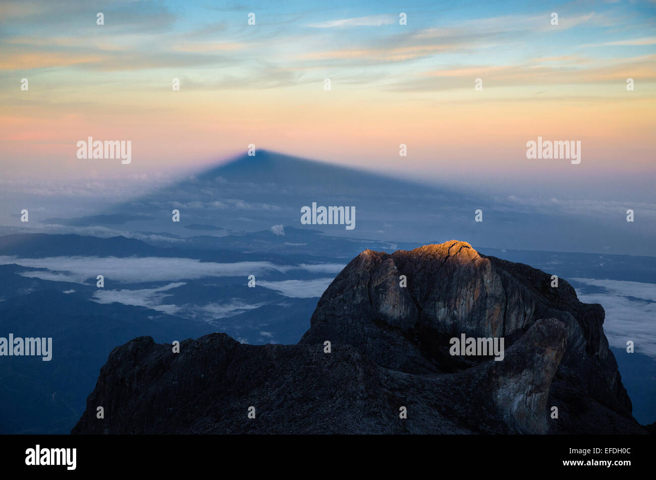 Shadow of Mount Kinabalu in Sabah Borneo at dawn from close to the summit - Stock Image