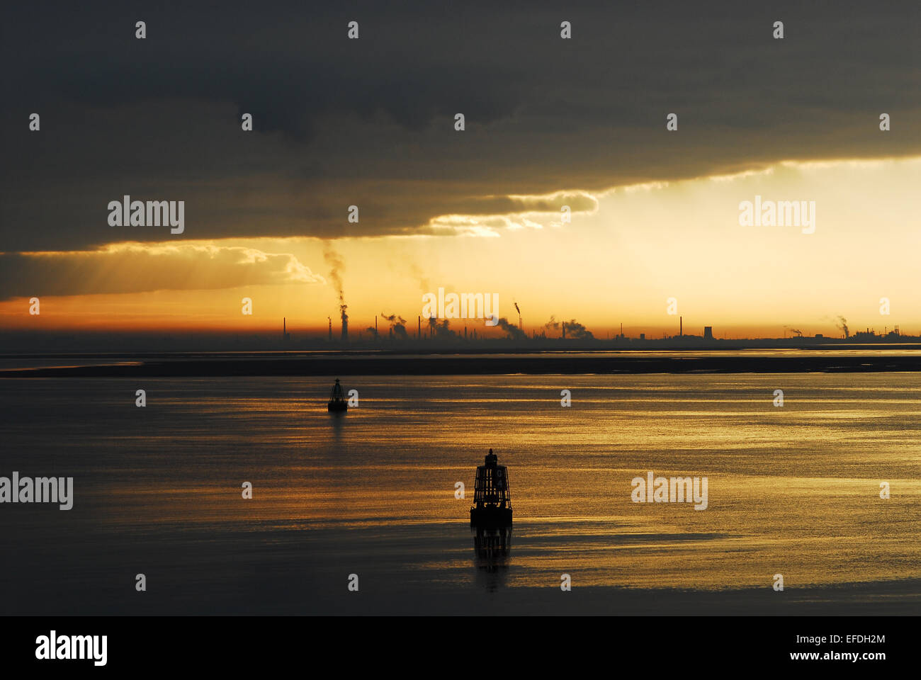 Smoke from from cooling towers at the Fiddlers Ferry power station can be seen across the River Mersey at sunrise. Stock Photo