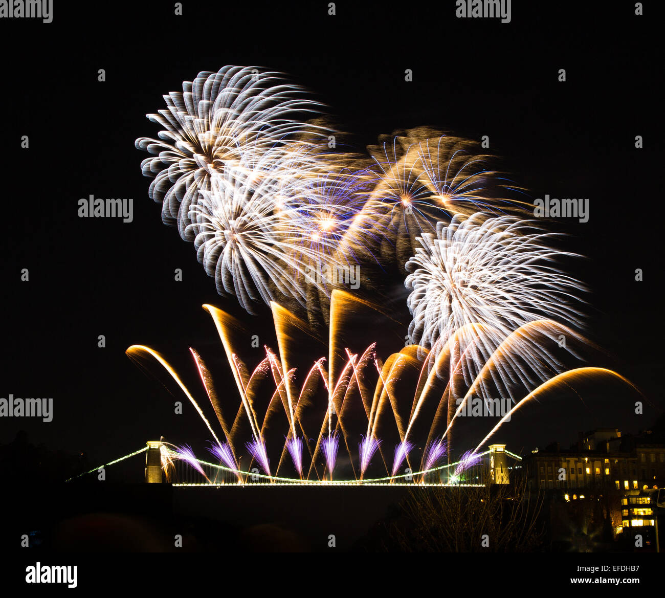 Firework display on the Clifton Suspension Bridge in Bristol to celebrate the 150th anniversary of opening of Brunel's - Stock Image