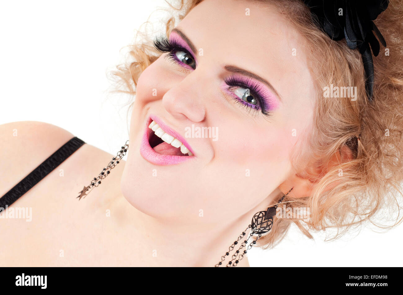 Blonde with fancy make-up grimacing - Stock Image