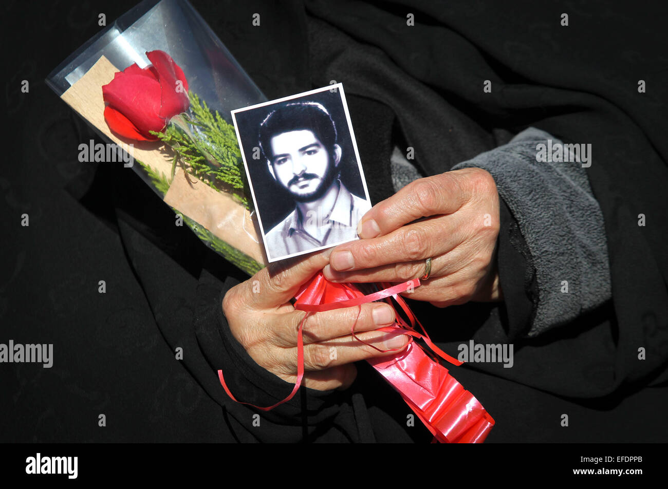 Tehran. 1st Feb, 2015. An Iranian woman holds a picture of her son who was killed during the 1979 Islamic revolution - Stock Image