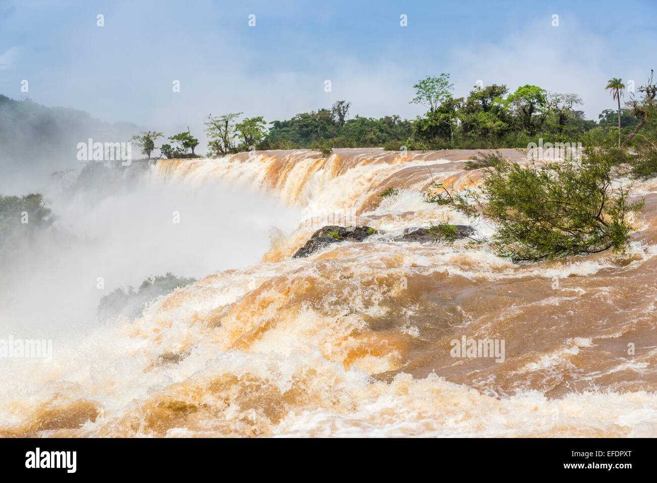 Natural wonders: View of the magnificent huge Iguazu Falls in full spate, viewed from the Argentinian side on a - Stock Image