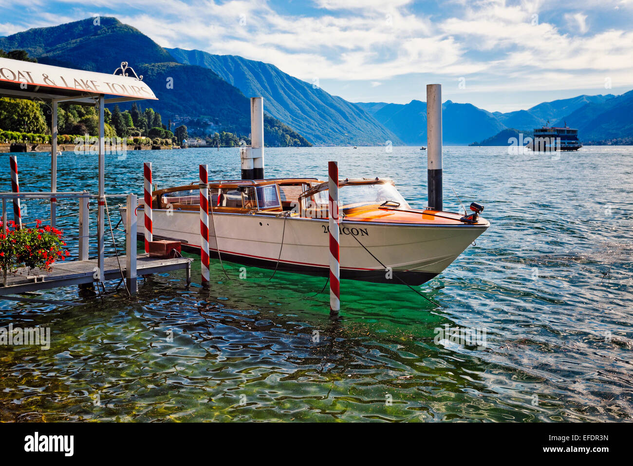 Small Tourboat Docked at a Pier, Bellagio, Lake Como, Lombardy, Italy - Stock Image