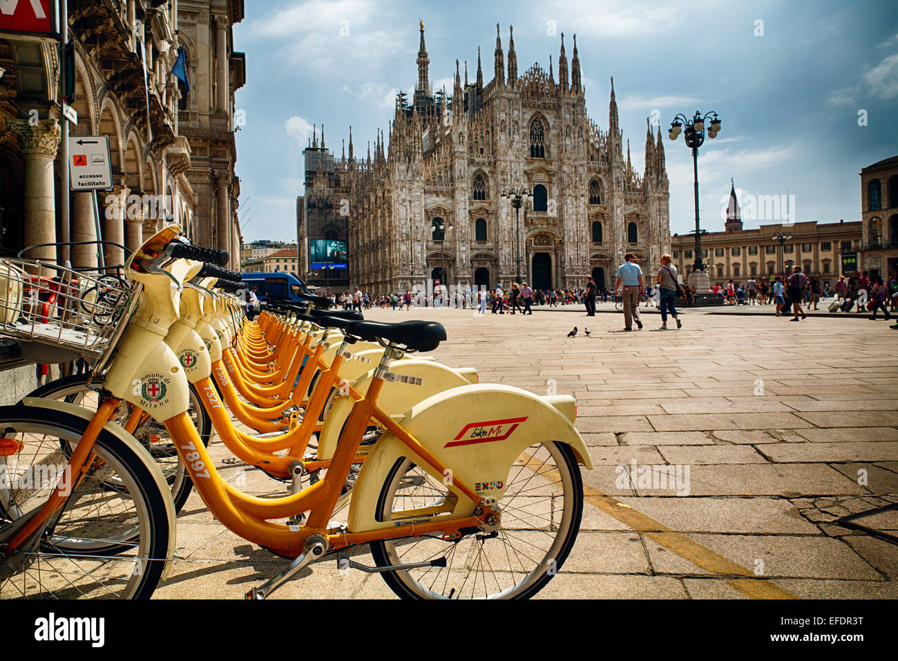 Low Angle View of a Square with Citibikes in the Background and a Cathedral in the Backround, Piazza Duomo, Milan, - Stock Image