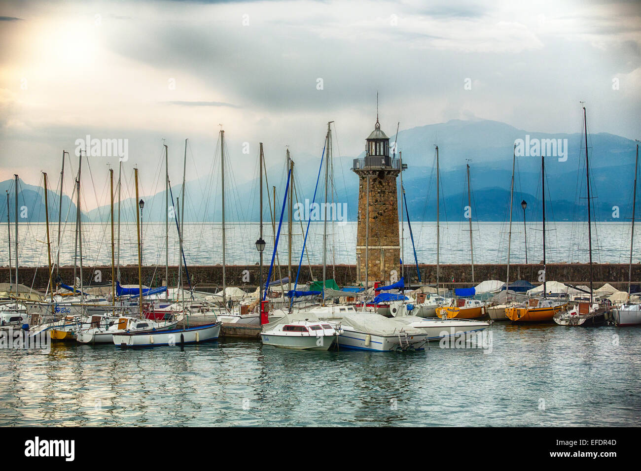 Harbor View with a Lighthouse, Desenzano, Lake Garda, Lombardy, Italy - Stock Image
