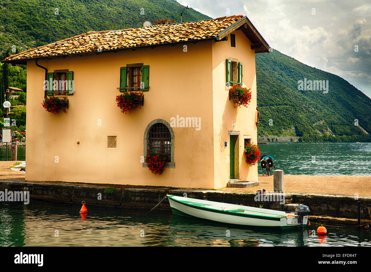 Low Angle View of a Small House on a Jetty, Riva Del Garda, Trentino, Italy - Stock Image