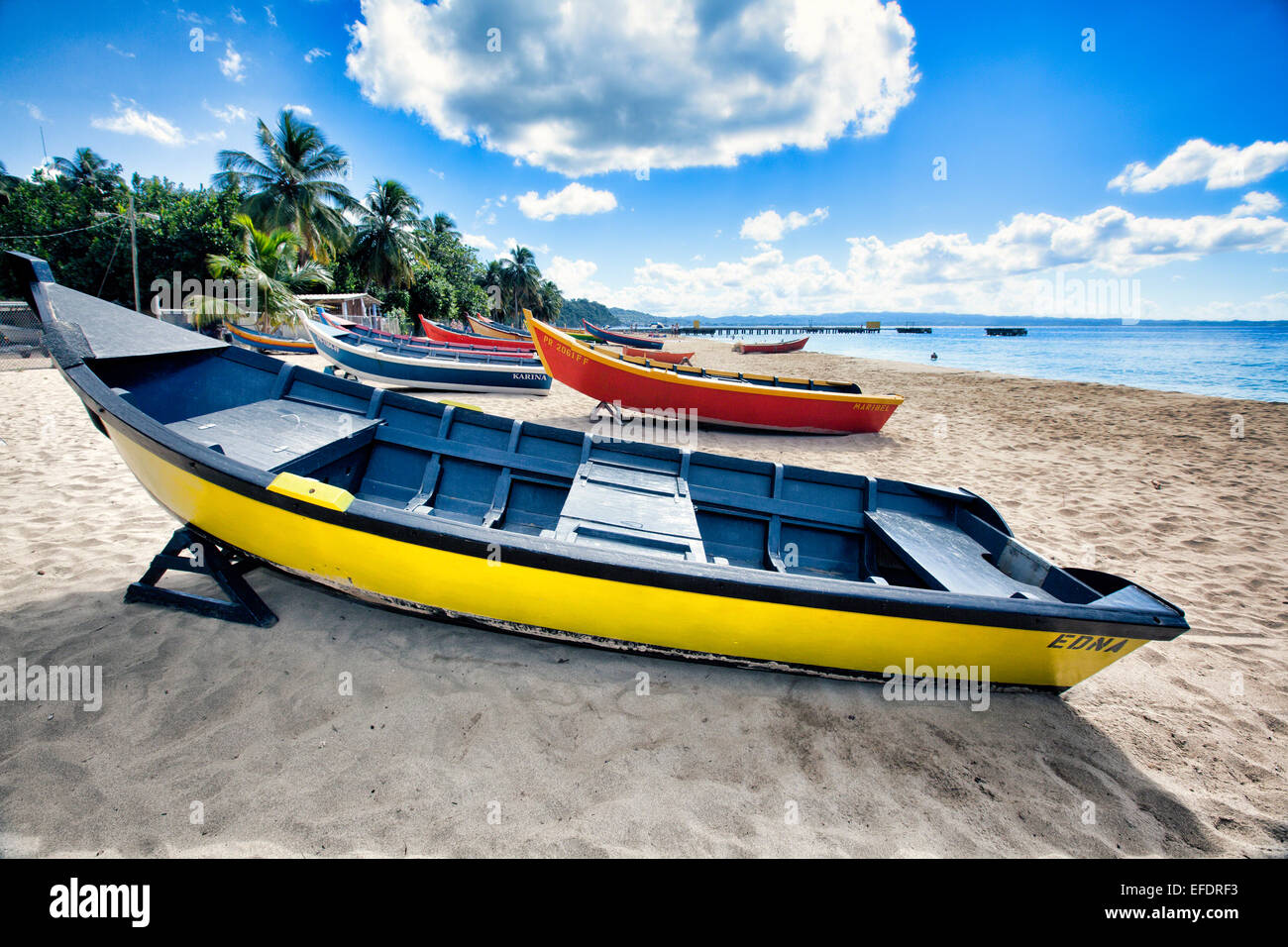 Low Angle View of Colorful, Small Wooden, Fishing Boats on a Caribbean Beach, Crashboat Beach, Aguadilla, Puerto - Stock Image