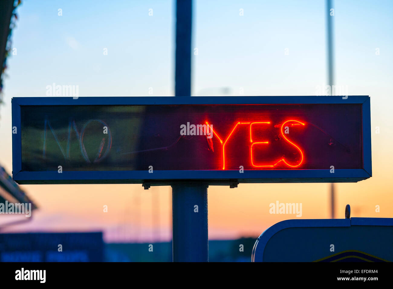 Neon sign Yes or No Vacancy at a US motel with Yes light switched on. - Stock Image