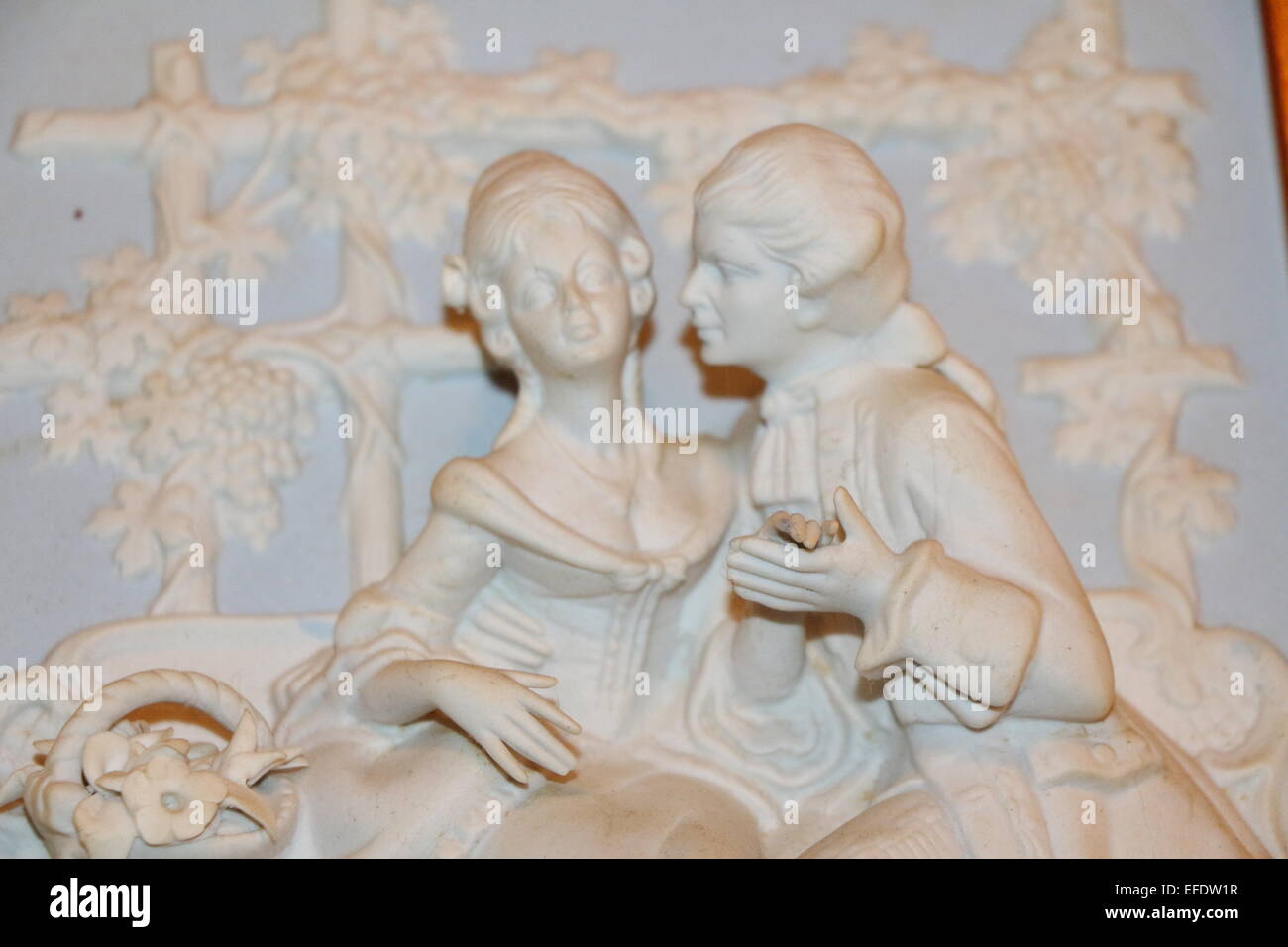man and woman courting scene, French lovers,man and woman on bench,lovers on bench,man takes womans hand - Stock Image