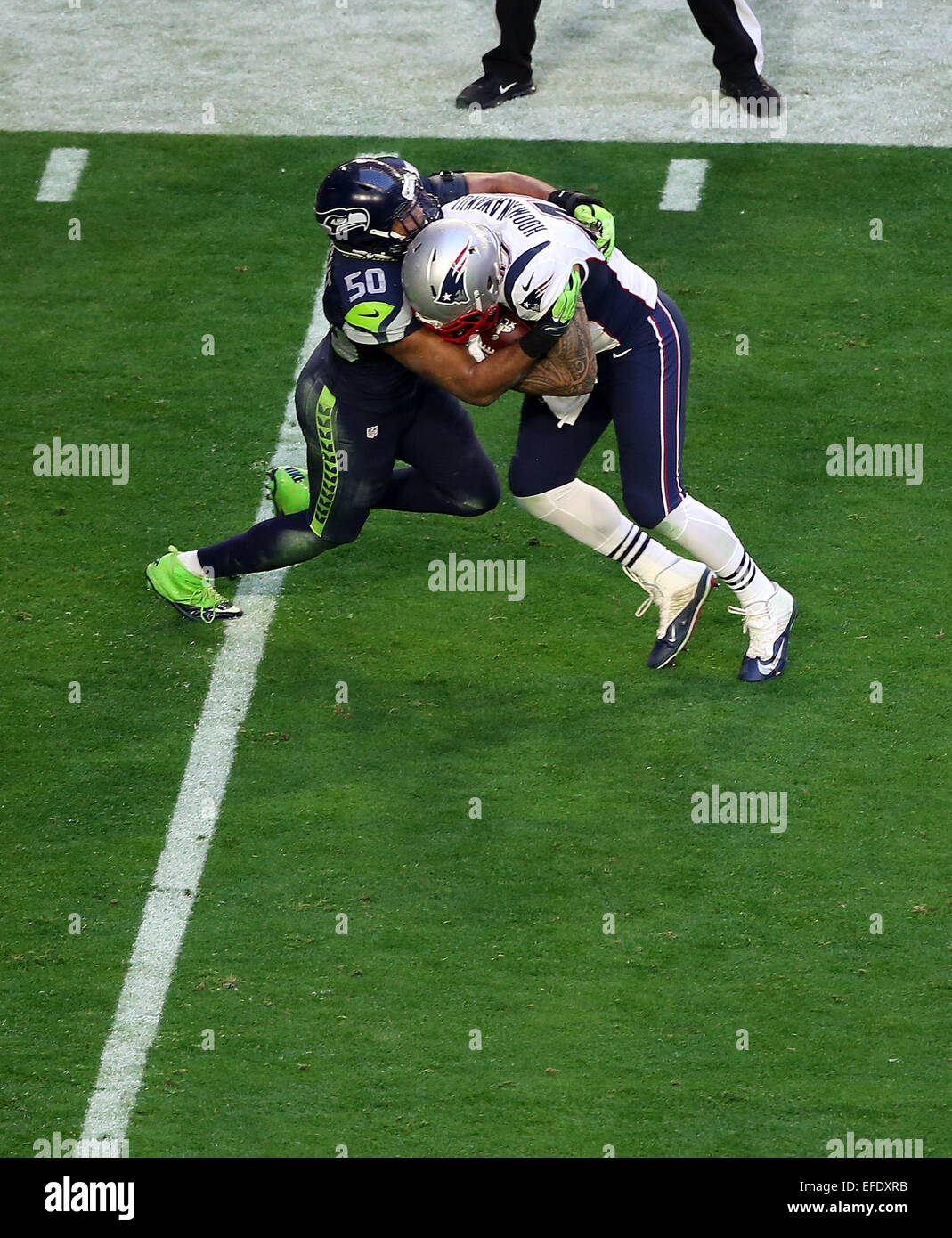 Glendale, Arizona, USA. 01st Feb, 2015. New England Patriots tight end Michael Hoomanawanui #47 is hit by Seattle - Stock Image