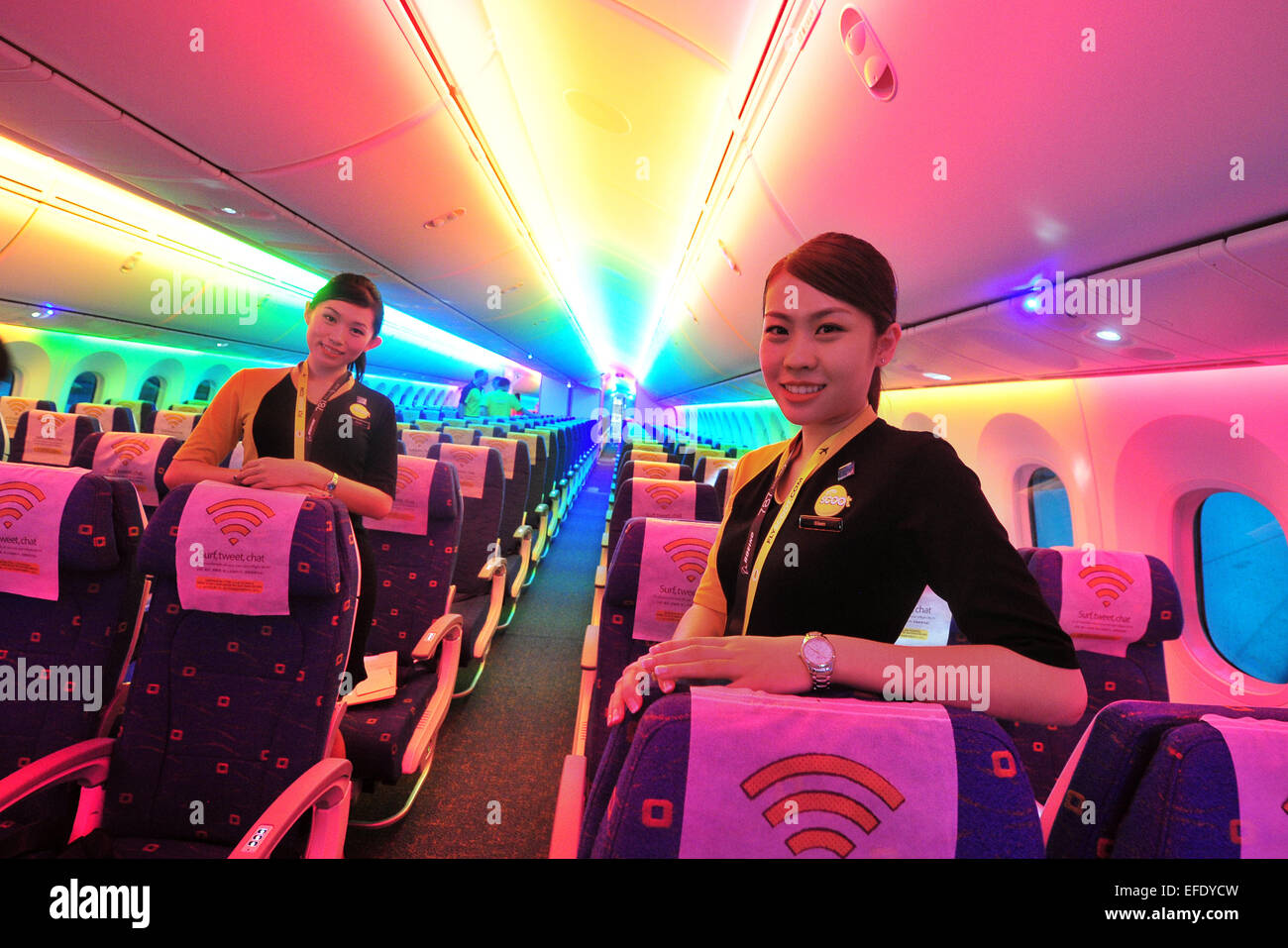 Singapore. 2nd Feb, 2015. Singapore's Scoot cabin crew welcome guests on the 'Dream Start' Boeing B787 - Stock Image