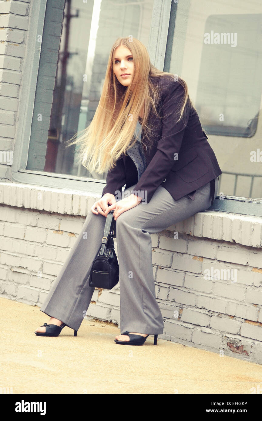 Fashion image of attractive woman with long blond hair. Photo has cross-process color effect. - Stock Image