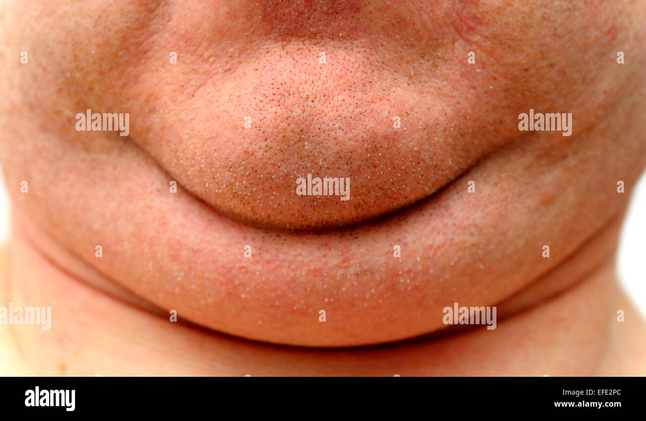 A man's face showing detailed close up of double chin - Stock Image