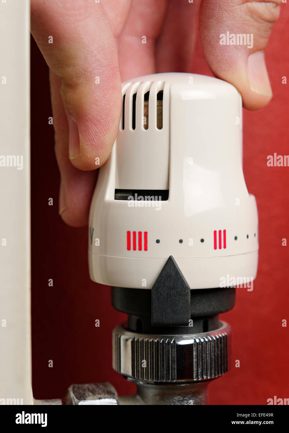 Adjusting the Thermostat on a Radiator, Close Up. - Stock Image