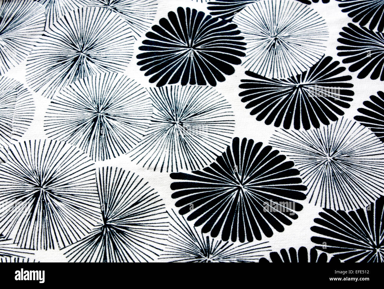 Abstract background of repeating circular flower pattern in black and white - Stock Image