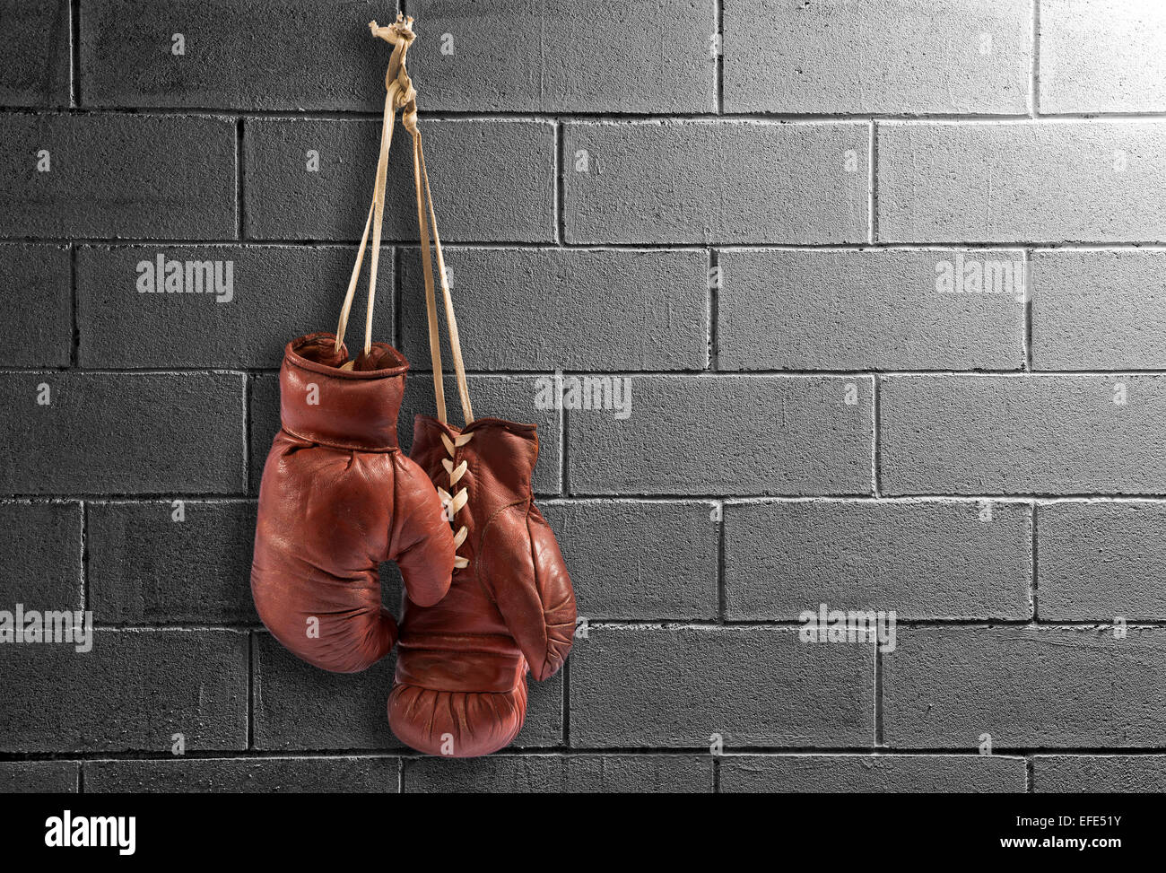 Pair of brown leather vintage boxing gloves - Stock Image