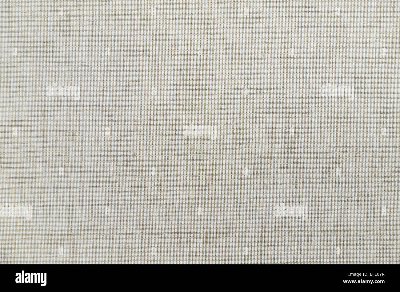 close up of a beige and white  flecked and striped place setting, detail, full frame, - Stock Image