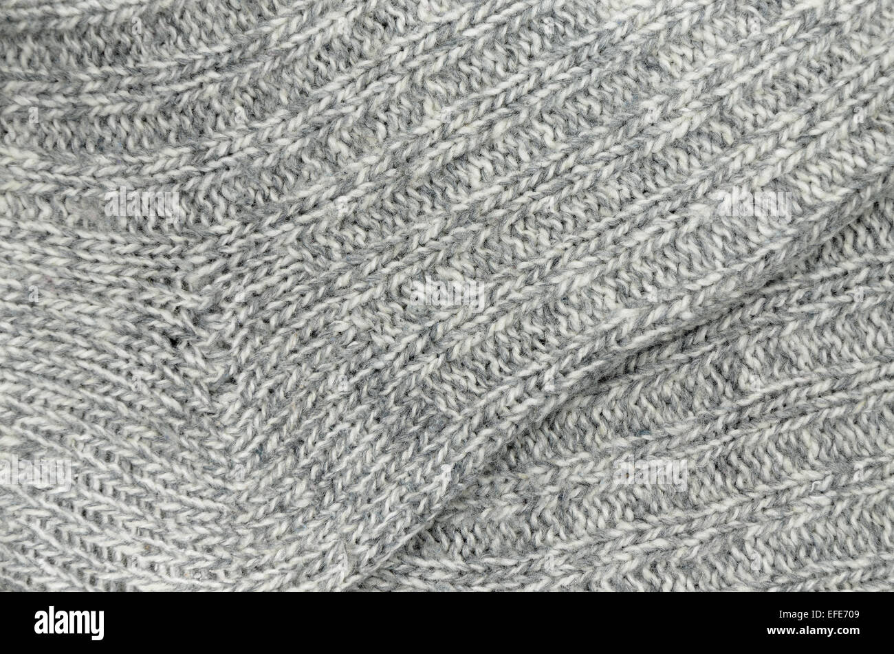 close up of two gray and white flecked and striped knitted socks, full frame - Stock Image