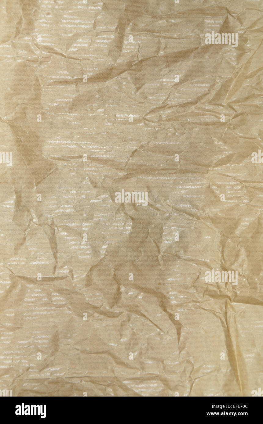 creased ocher greaseproof paper, blank, close up, full frame, vertical - Stock Image