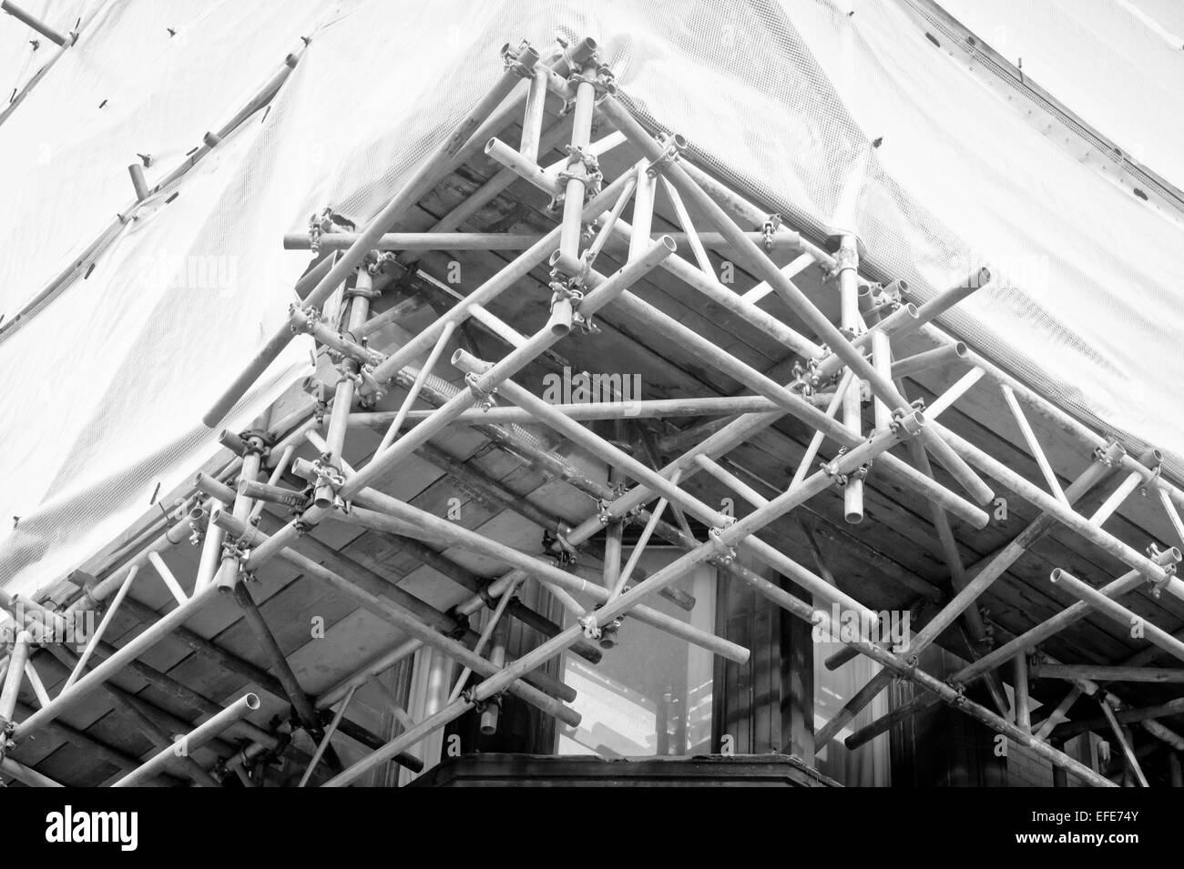 Details of scaffolding bars on a building - Stock Image