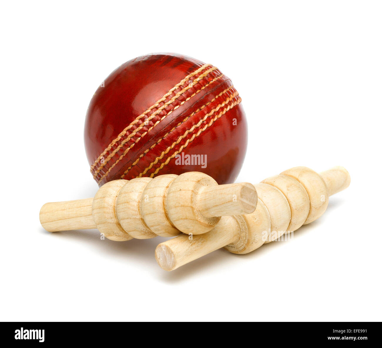 Red Leather Cricket Ball with Bails - Stock Image