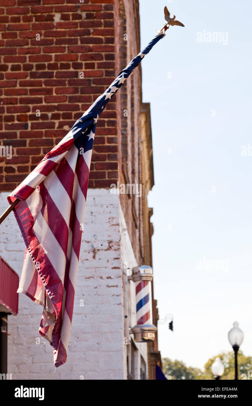 Stars and stripes and a revolving Barbers Pole on a shop in Fort Mill South Carolina Unites States of America USA - Stock Image