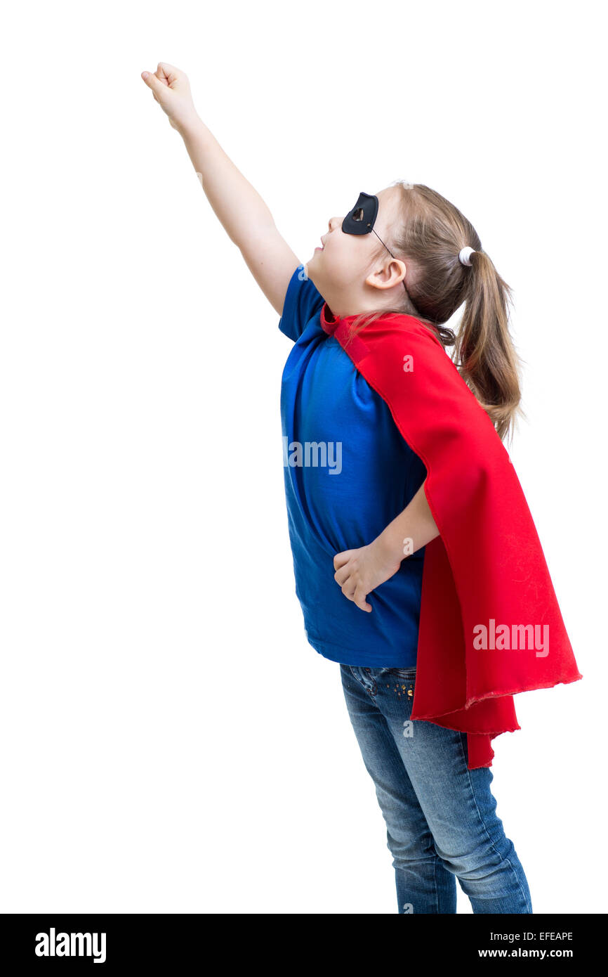 young girl dressed up as superhero with mask and cape - Stock Image