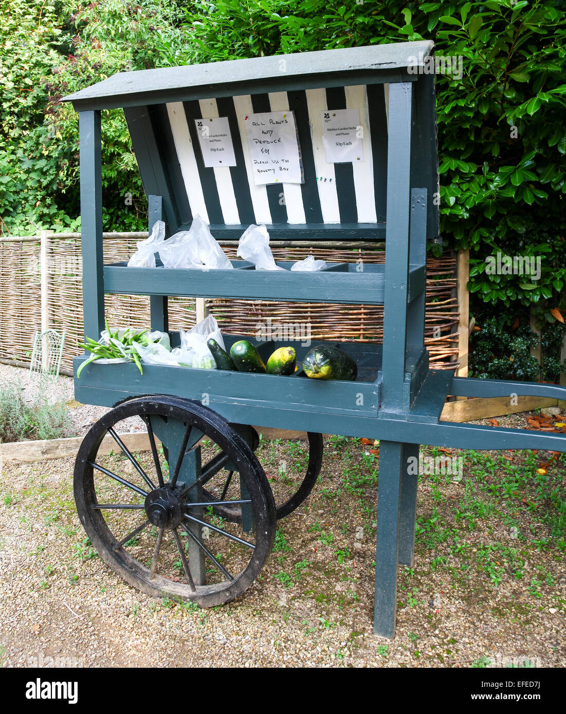 A barrow selling home grown or produced produce of fruit and vegetables at Biddulph grange Stoke on Trent Staffordshire - Stock Image