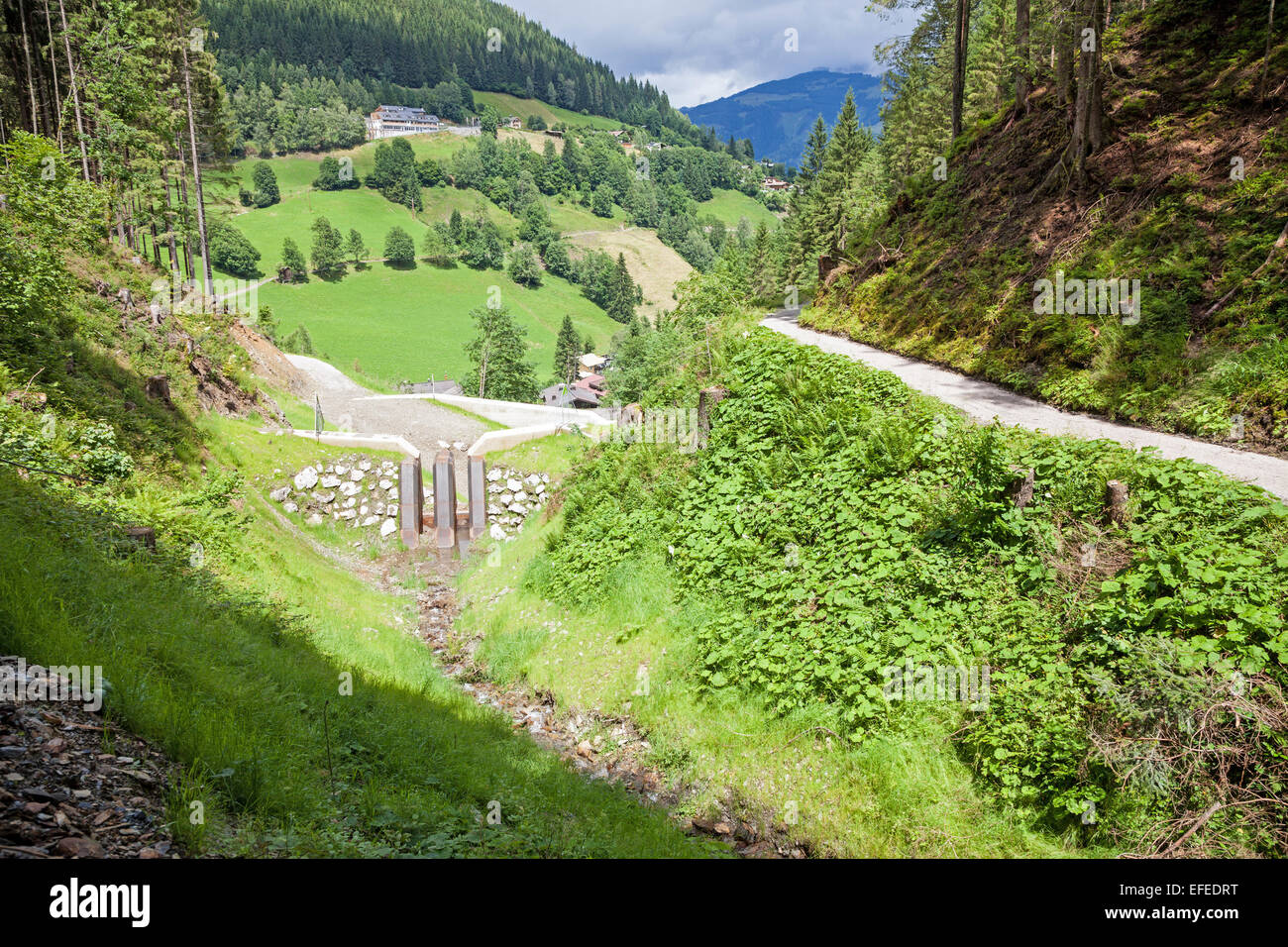 Flood prevention measures next to the path to the top of the Schmittenhöhe Zell am See Austria in summer - Stock Image