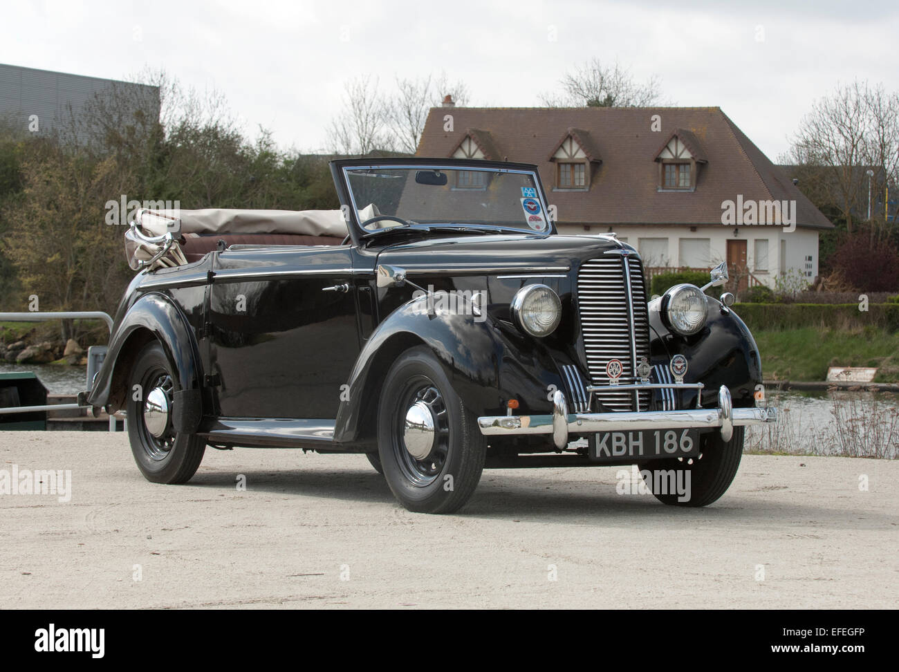 1939 Hillman Minx convertible driving on a country lane, British pre war family car - Stock Image