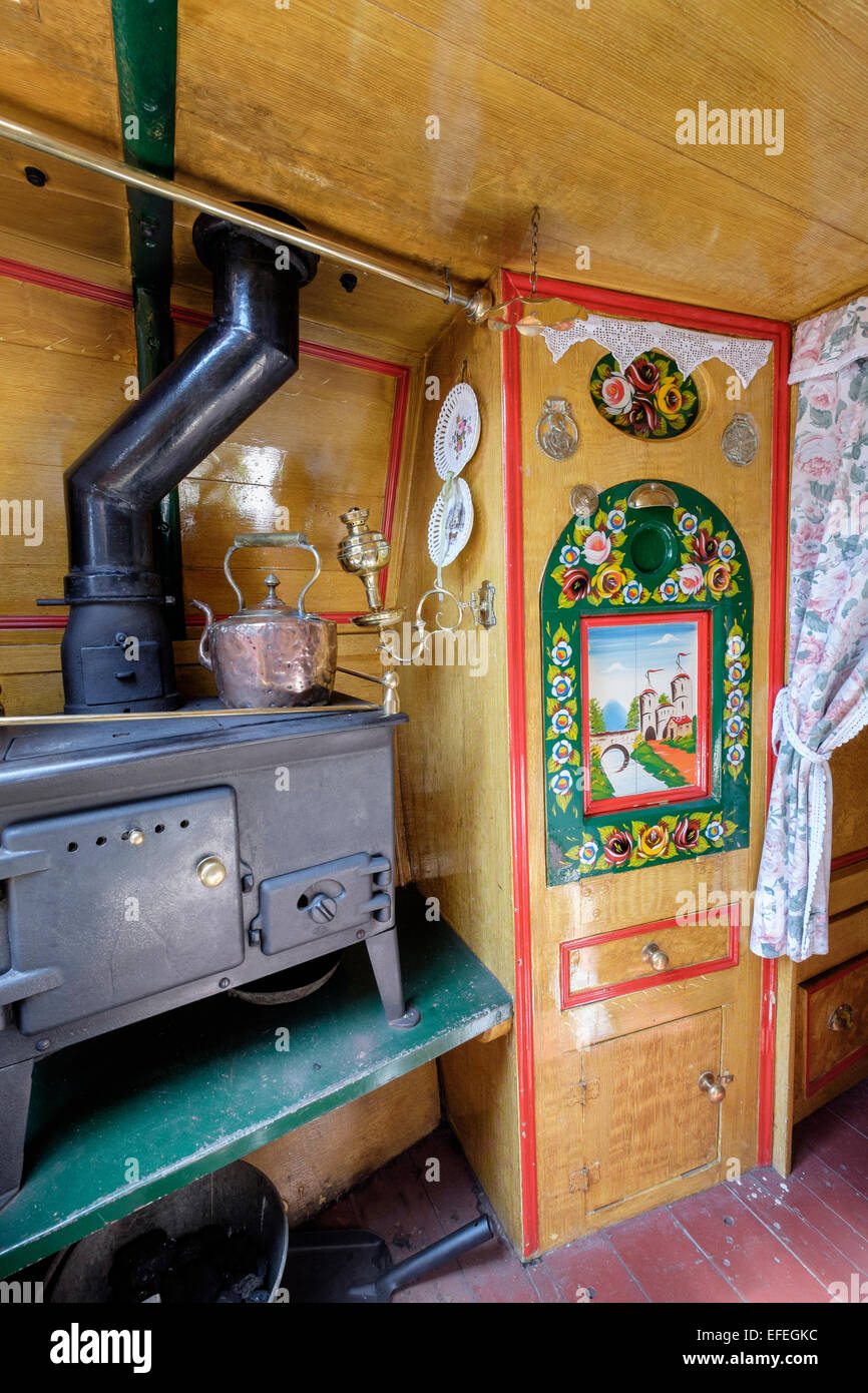 Interior of traditional canal narrowboat kitchen at National Waterways Museum. Ellesmere Port, Cheshire, England, - Stock Image