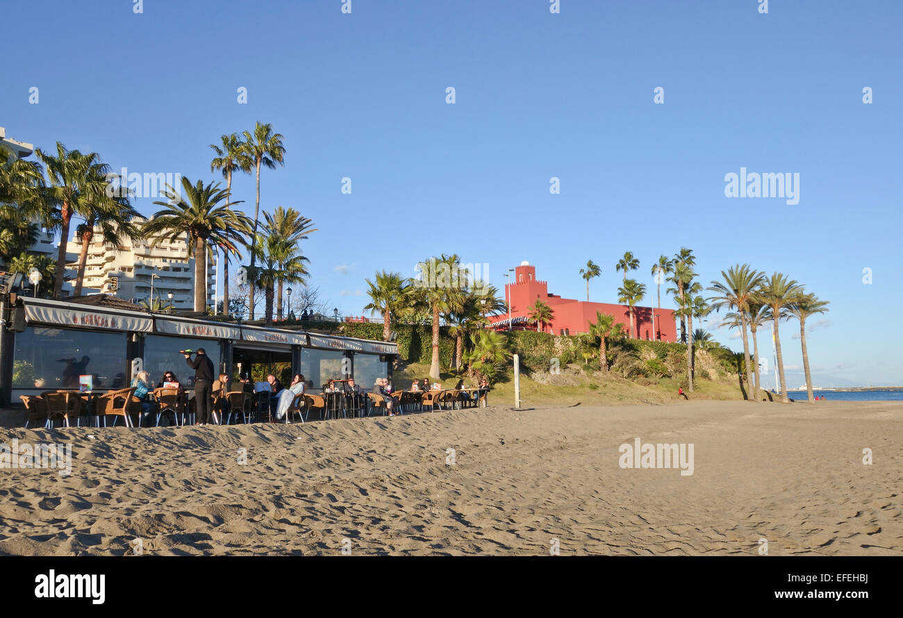 Bar at beach with the Bil Bil Castle, Arabic-style building behind, Benalmadena, Andalusia, Southern Spain. - Stock Image