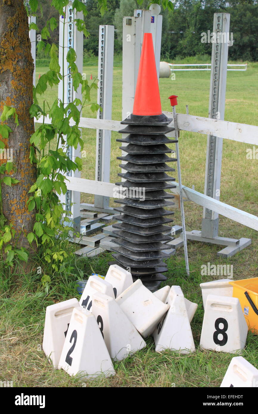 Red cones used for equitation obstacles in show jumping contests - Stock Image
