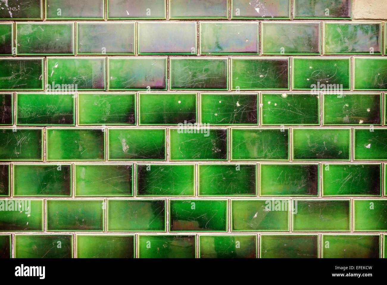Green grungy tile wall background or texture. - Stock Image