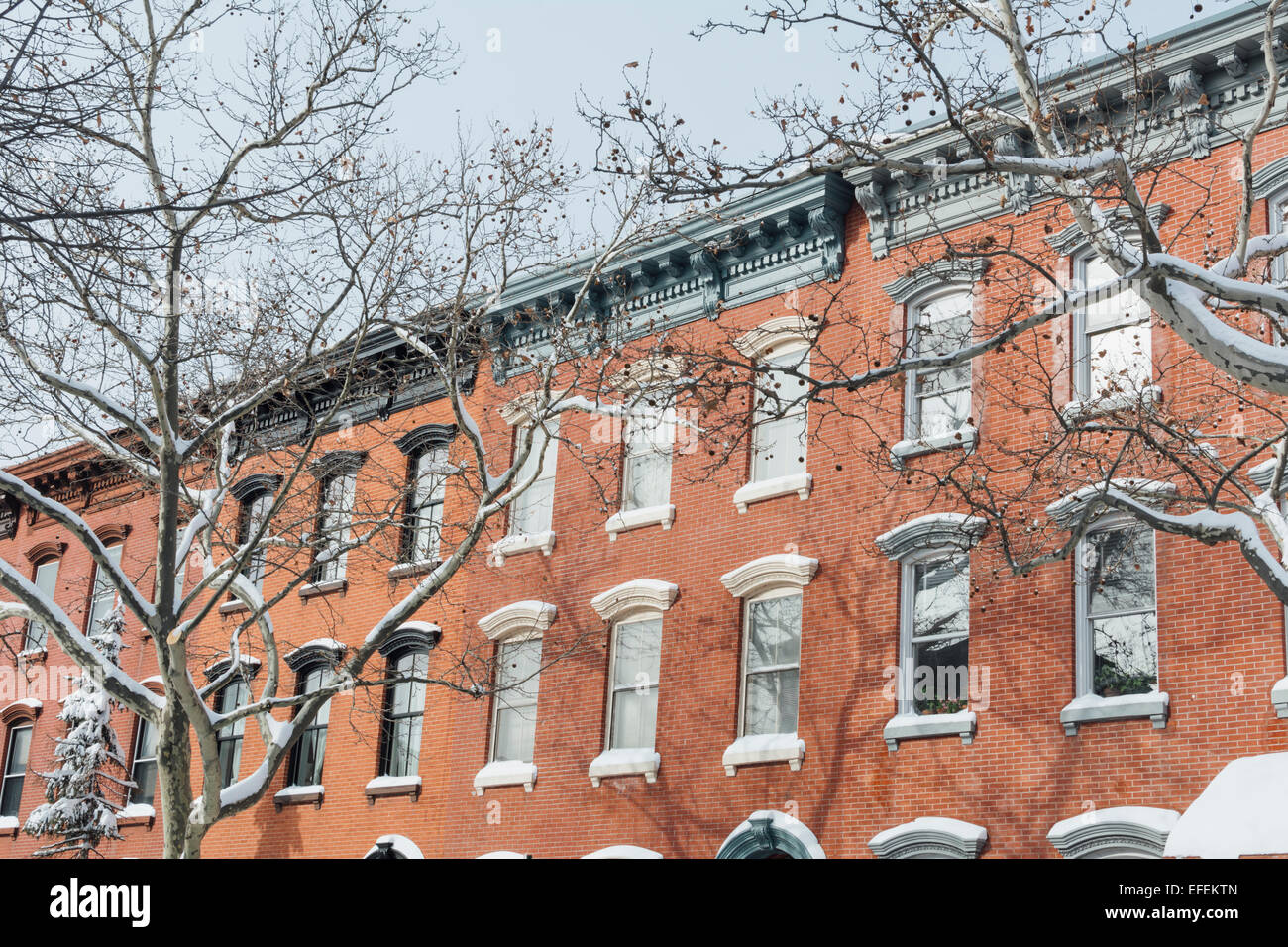 Exterior of row houses covered with snow. Greenpoint Brooklyn. New York City - Stock Image