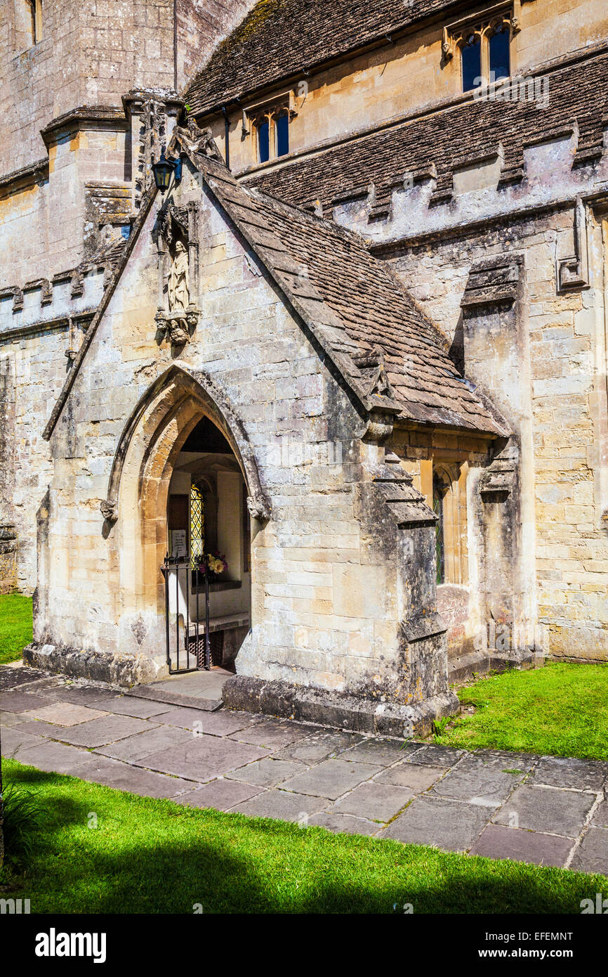 The porch of St. Andrew's church in the Cotswold village of Castle Combe in Wiltshire. - Stock Image