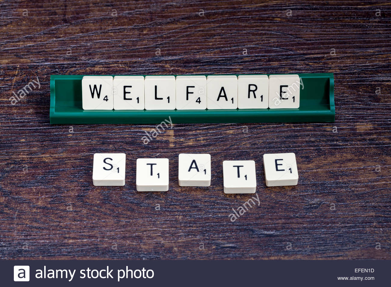 Welfare State spelled out with scrabble letters - Stock Image