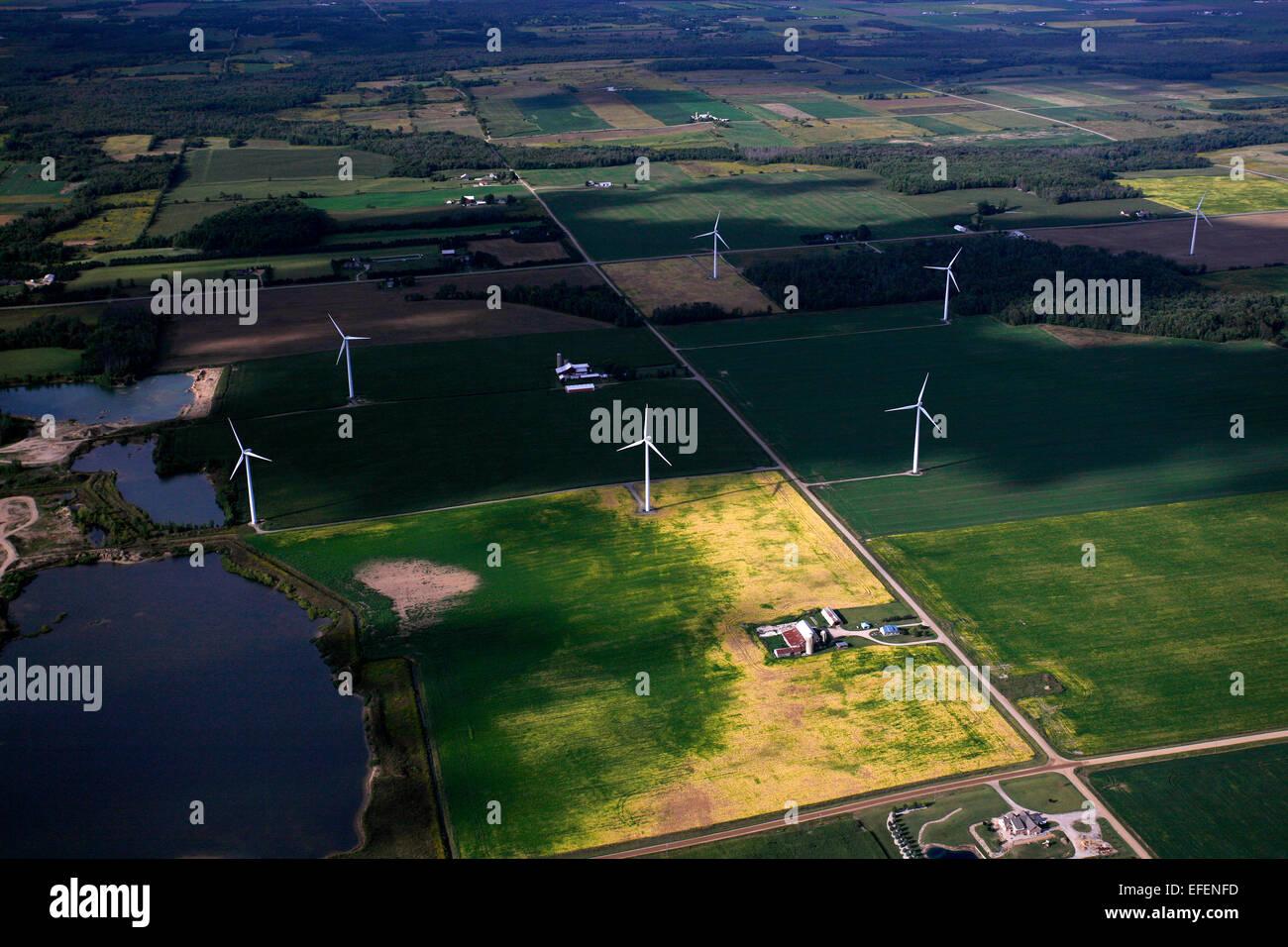 Wind turbines amongst farmland in the Saginaw Bay area. - Stock Image