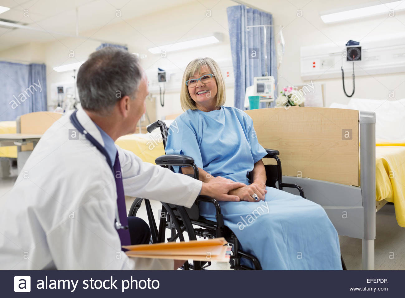 Man And Hospital Gown And Wheelchair Stock Photos & Man And Hospital ...