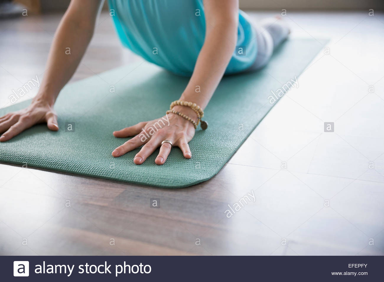 Woman practicing yoga in cobra pose - Stock Image
