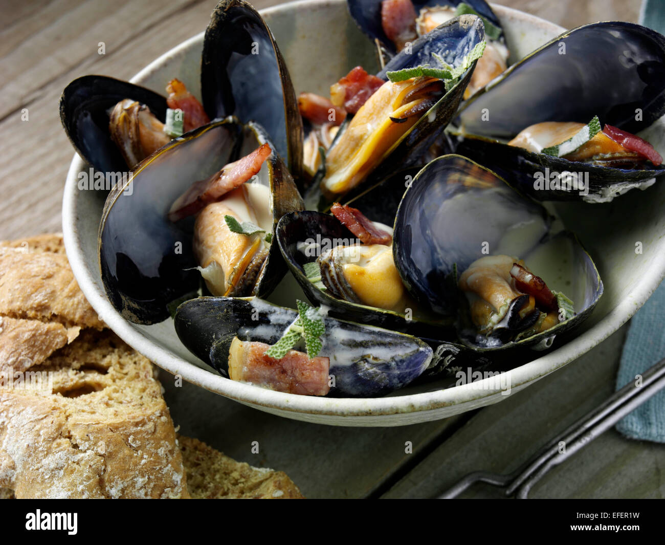 Mussels with cider and smoky bacon - Stock Image
