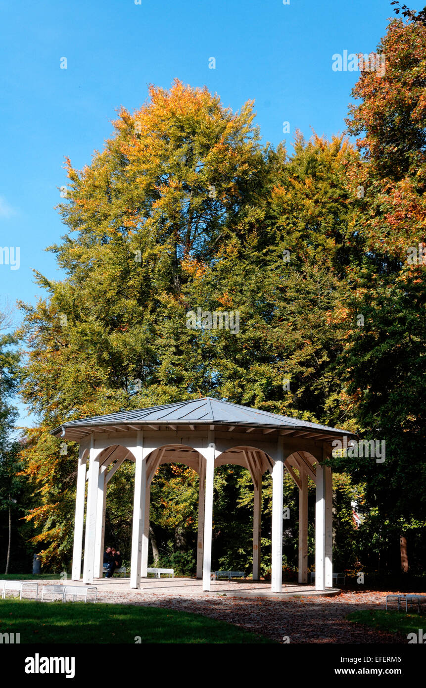 People sitting in a Bandstand in a park in Arlen Germany Stock Photo