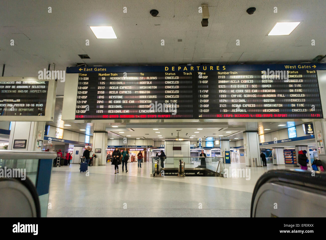 The Amtrak departure board in an empty Penn Station in New York shows a mix of on time and cancelled trains on Tuesday, - Stock Image