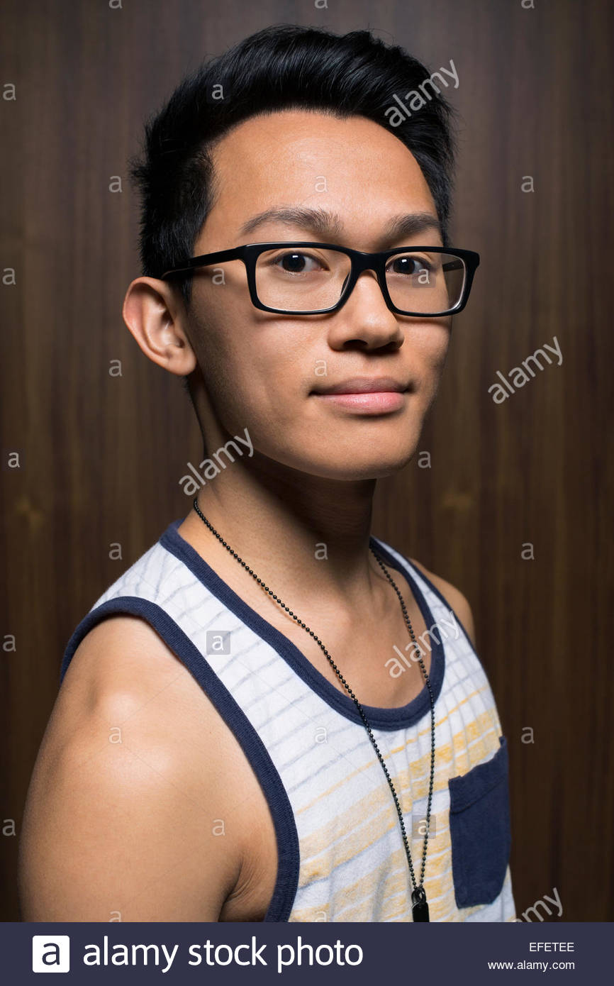 Portrait of man wearing tank top and eyeglasses - Stock Image