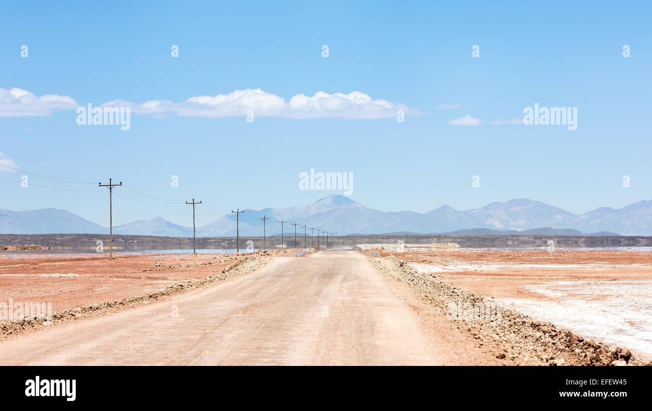 Mirages over Uyuni desert road, Altiplano, Bolivia, South America - Stock Image